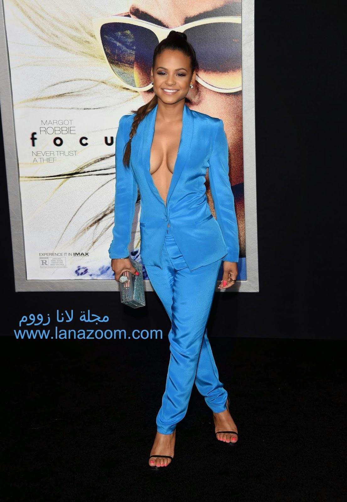 كريستينا ميليان  بثوب يظهر الكثير من جانب صدرها خلال حفل افتتاح فيلم Focus