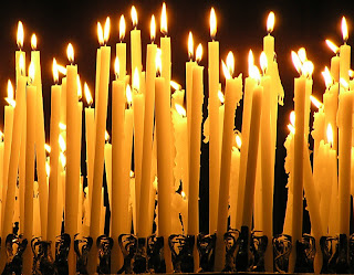 many candles burning in the darkness and making it light