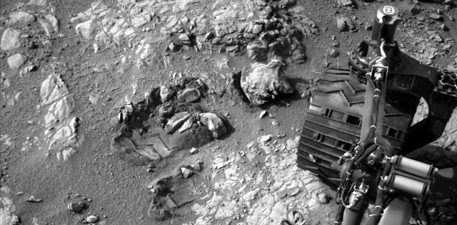 "This view of Curiosity's left-front and left-center wheels and of marks made by wheels on the ground in the ""Yellowknife Bay"" area comes from one of six cameras used on Mars for the first time more than six months after the rover landed. The left Navigation Camera (Navcam) linked to Curiosity's B-side computer took this image during the 223rd Martian day, or sol, of Curiosity's work on Mars (March 22, 2013). The wheels are 20 inches (50 centimeters) in diameter. Image credit: NASA/JPL-Caltech"