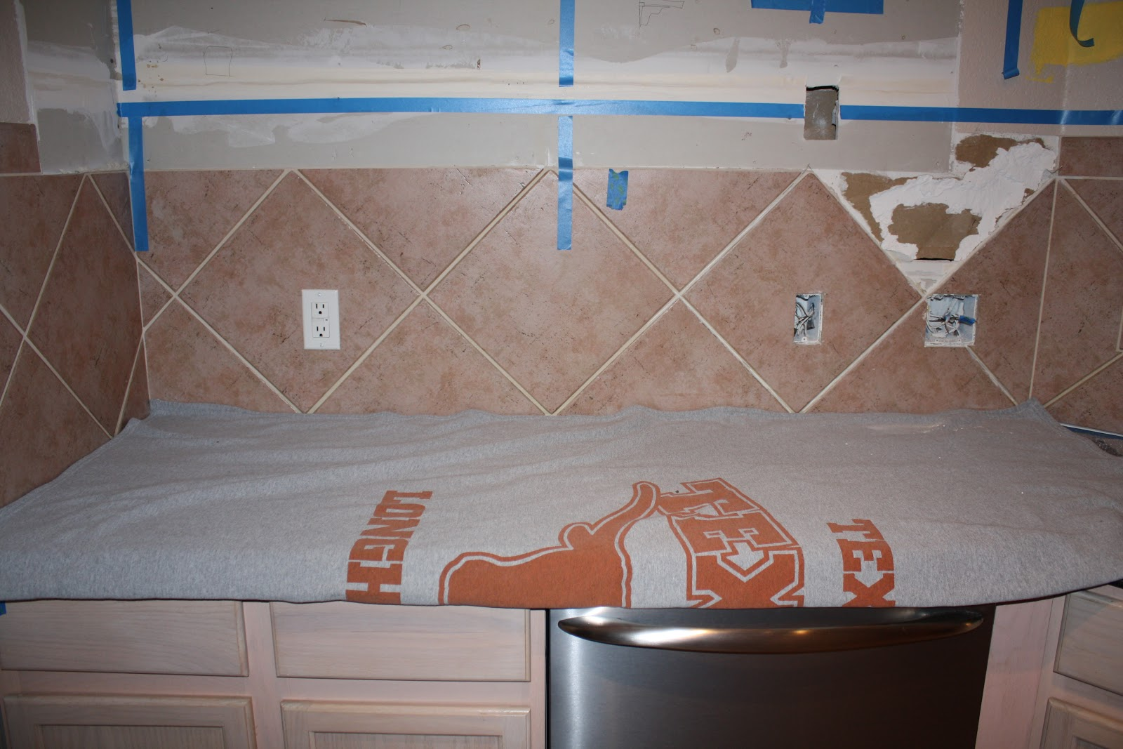How to remove backsplash tiles - On The Ends Of The Backsplash There Are Just Two Extra Tiles That Are Higher Than The Rest So Jerry Told Me To Remove Those By Cutting Through The Grout