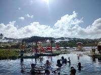 Banho de rio na praia naturista de Massarandupió - Bahia
