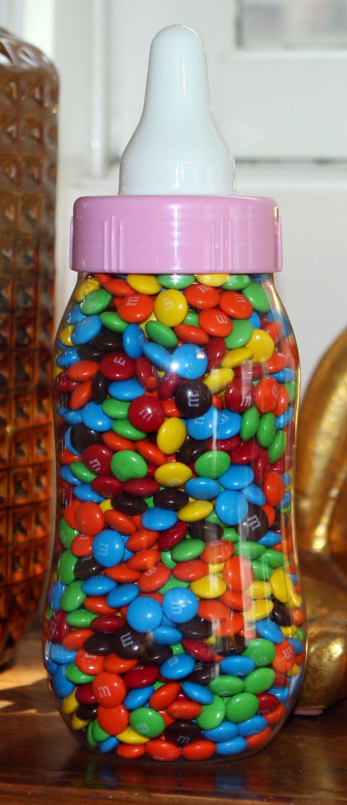 Awesome Large Baby Bottle Shaped Bank Filled With Candies. Guess How Many Are In It.
