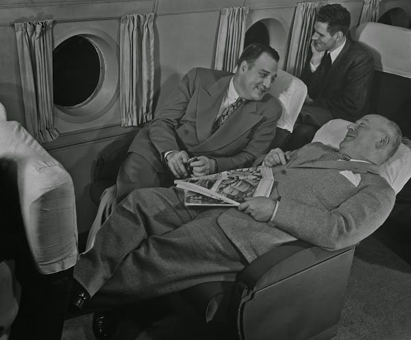 Passengers relaxing on an airline flight, circa 1950.