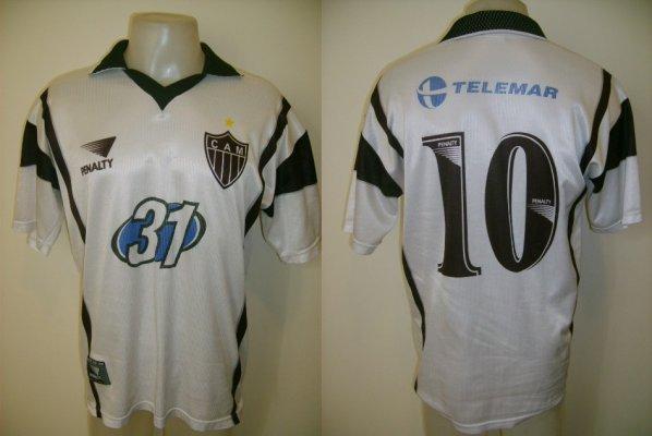 Atlético-MG com camisa azul, logotipo da telemar, galo com uniforme azul