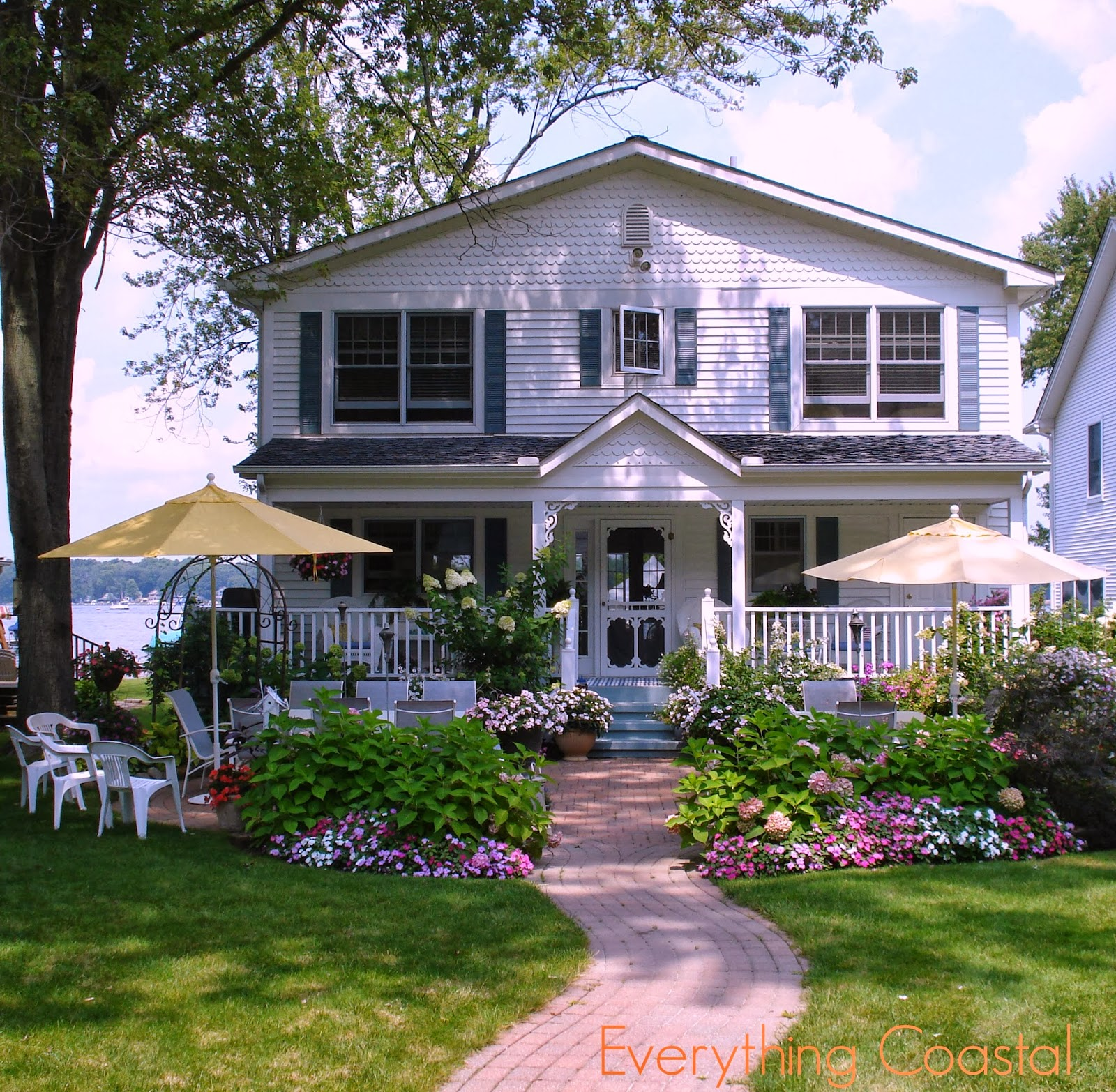 Everything coastal a michigan lakefront storybook cottage for Waterfront cottage