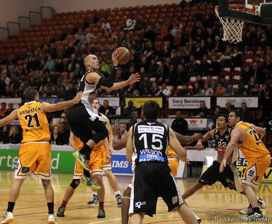 With ball: Paora Winitana, HBS Bank Hawks, Hawke's Bay - basketball vs Taranaki Mountain Airs, Pettigrew.Green Arena, Taradale, Napier photograph
