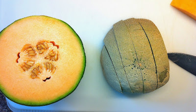 Slicing the melon for the easy to make fruit arrangement.