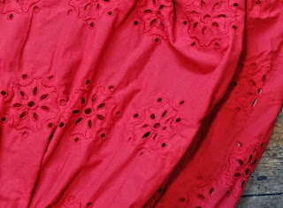 Red broderie fabric