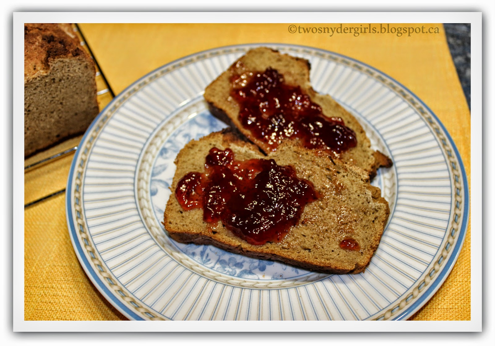 two slices of Sweet Potatoe Bread with fresh strawberry jam