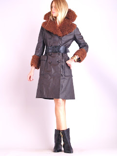Vintage 1970's brown leather coat with front button closure and large mongolian fur trim collar.
