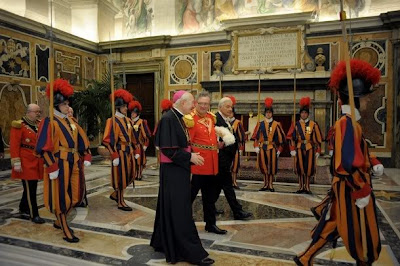 Archbishop James Harvey escorts the new Grand Master of the Knights of Malta, Matthew Festing of Britain, before his meeting with Pope Benedict XVI at the Vatican