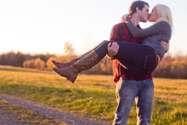 boyfriend holding up girlfriend