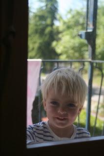 Anton on Heybeliada on the balcony, photo through the window.