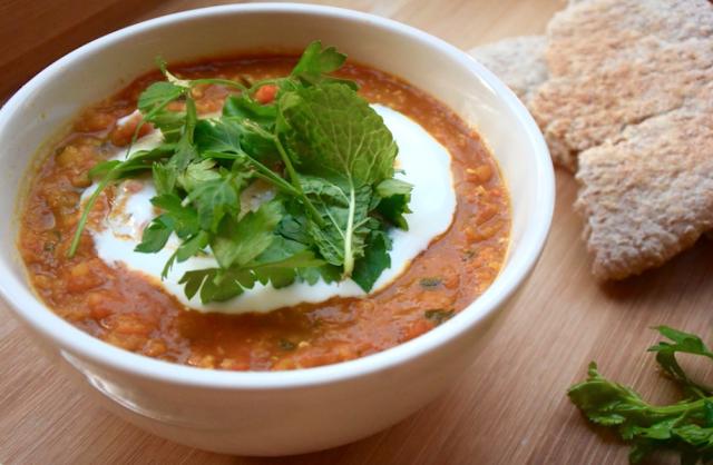 Vegan Afghan vegetable soup (havij) with lentils and fresh herbs