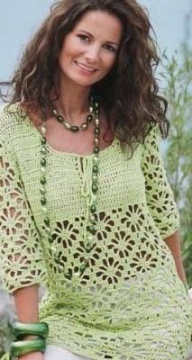 Красивая и женственная зеленая туника