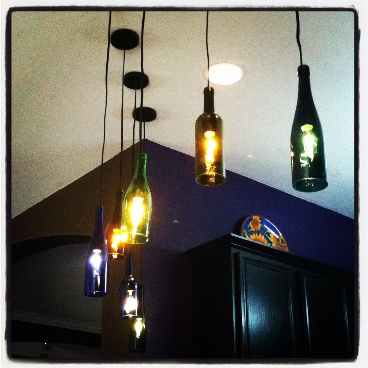 The half assed decorator ultra cool wine bottle light fixtures - Wine bottle light fixtures ...