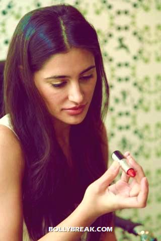, Nargis Fakhri Applying Lipsticks To Her Lips