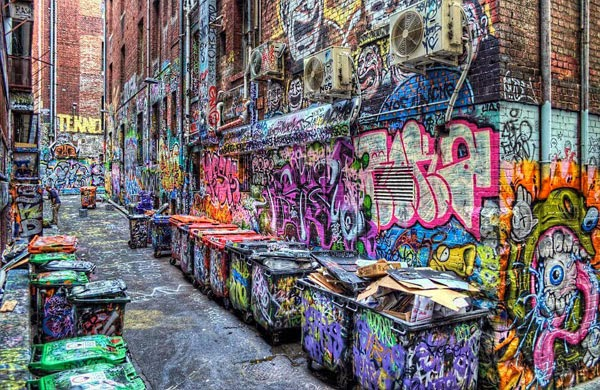 a comparison of the street art and vandalism Graffiti: art or vandalism depends who in louisville you ask the spray-painting of symbols and pictures on buildings — known as graffiti, which is illegal in many.