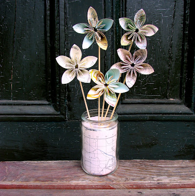 How to fold paper flowers just imagine daily dose of creativity i wrapped some map paper inside a mason jar and placed a lump of old play dough in the bottom to insert the skewers into the vase mightylinksfo