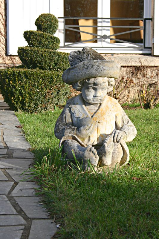 stone figure of seated child