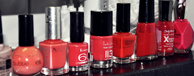 Nagellacke in Rot, Koralle & Lachs