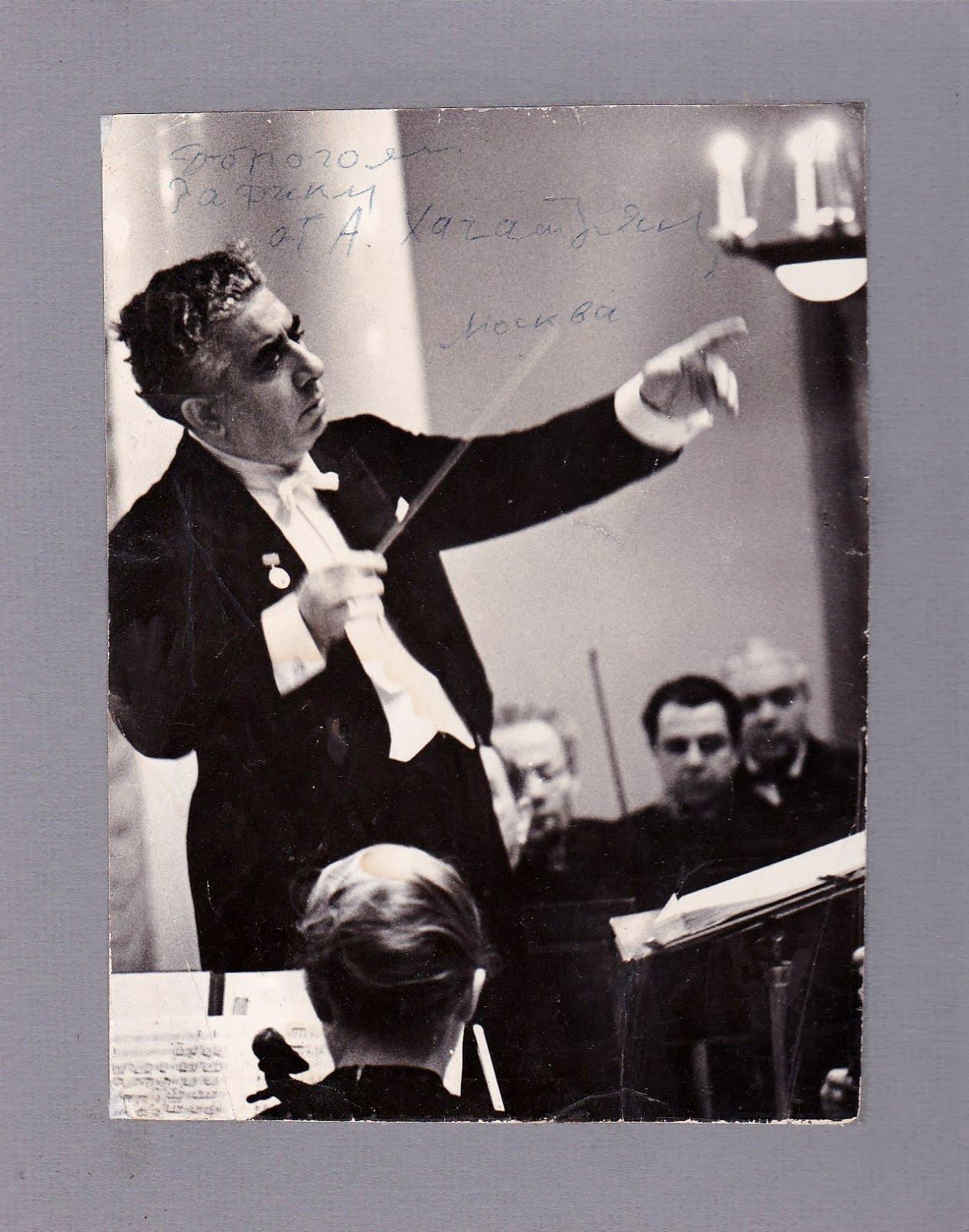Composer Aram Khatchaturian autographs a photograph conducting the Leningrad Philharmonic