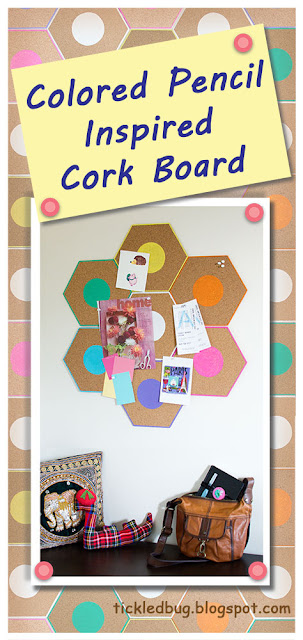 Cork bulletin board painted to look like the tops of colored pencils hanging on the wall with papers pinned to it