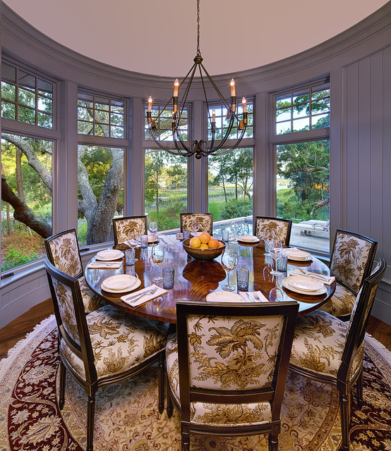 Beautiful Pattern on the Wooden Chairs around a Wooden Round Dining Tables under the Iron Chandelier