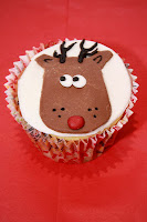 Christmas cupcake topped with a fondant Rudolf the reindeer head picture