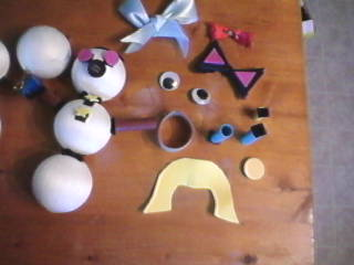 Make a Potato head style toy from recycled Christmas Decorations and Ornaments.