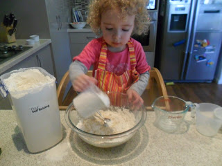 Measuring flour for the Strawberry Muffins