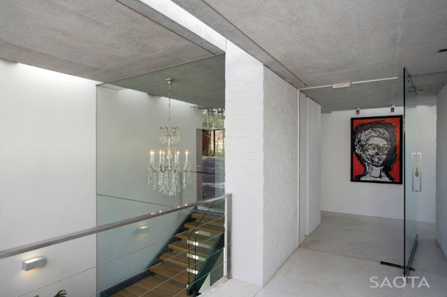 Photo of white painted walls in the hallway of Glen House with glassy walls