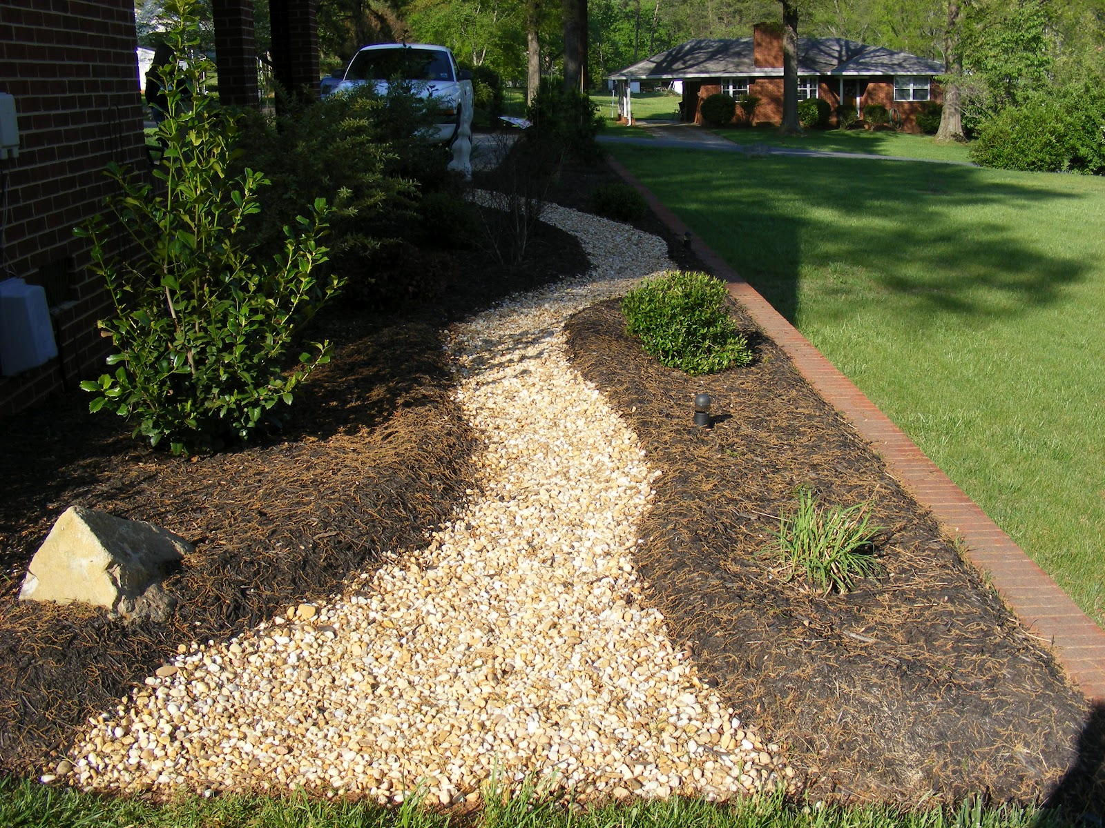 Wayne dickerson landscaping llc sculptured mulch with for Landscaping rocks winston salem nc