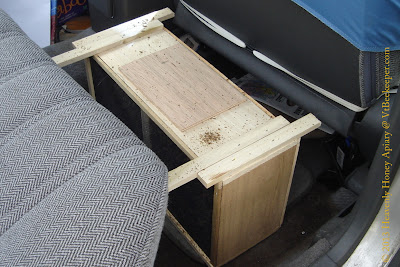package of bees in back seat of car image