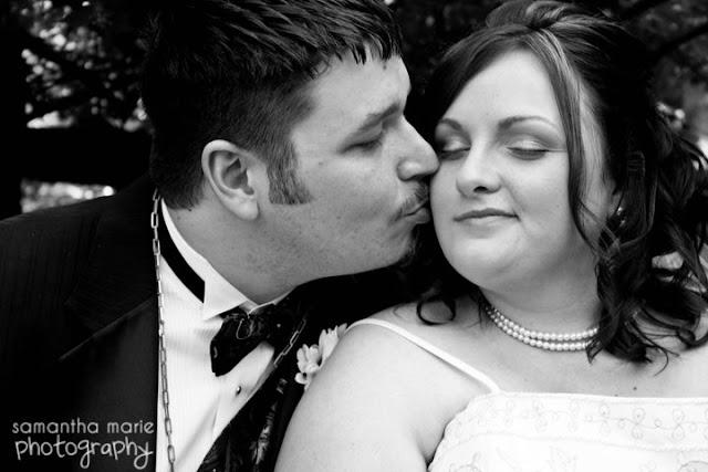 groom kissing his bride on the cheek