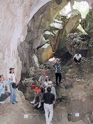 Awesome site: A filepic of participants of the Perak Heritage Society's Lenggong Valley Trail admiring the cave where the skeleton of the famous Perak Man was found in Gua Gunung Runtoh.