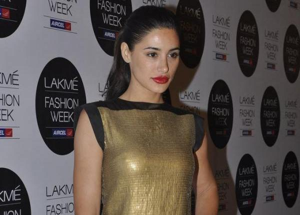 Nargis Fakhri in golden dress - Nargis Fakhri in golden Dress at Lakme Fashion Week 2012