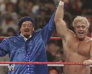 WWF / WWE: Wrestlemania 5 - Dino Bravo (with Frenchy Martin) celebrates his win over Rugged Ronnie Garvin