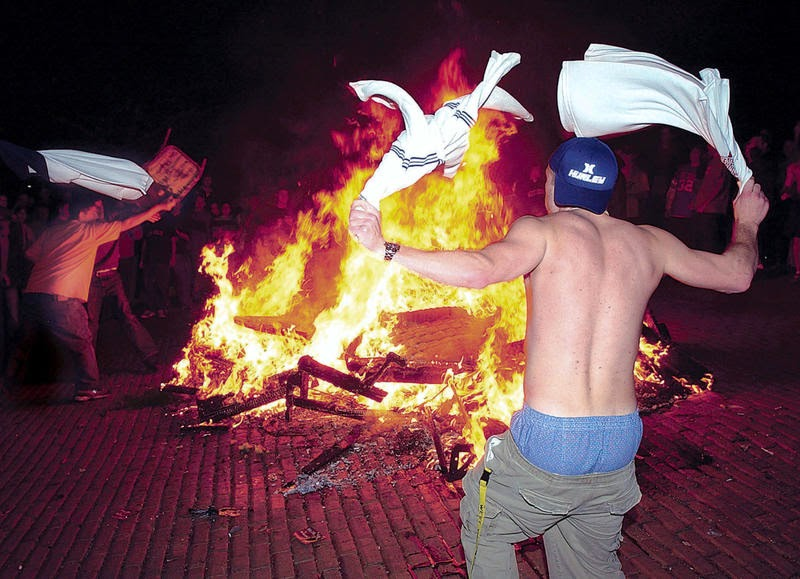 The Fallout: Morgantown, WV. cracks down on West Virginia supporters burning patio furniture.