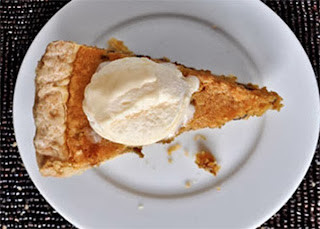 Pumpkin Sponge Tart: A pumpkin-based sponge mixture baked in a shortcrust shell, served as a wedge with a cream topping