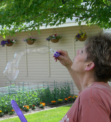 Picture of Marlene Terry blowing bubbles with her grandson