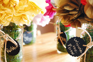 Vet School Widow | Tissue paper pom bouquets in Mason jars with miniature chalkboard tags.  An easy DIY centerpiece for a baby shower.