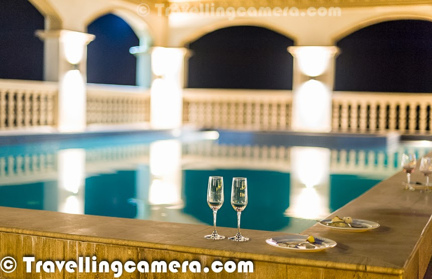 Empty wine glasses around the pool on the Terrace  Four Seasons Vineyard in Baramati, Maharashtra, India