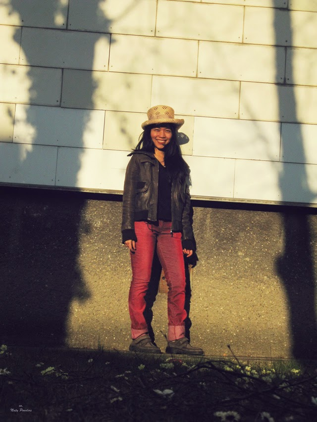 Spring transition outfit: thrifted leather jacket, red cord pants, straw hat, man suede shoes