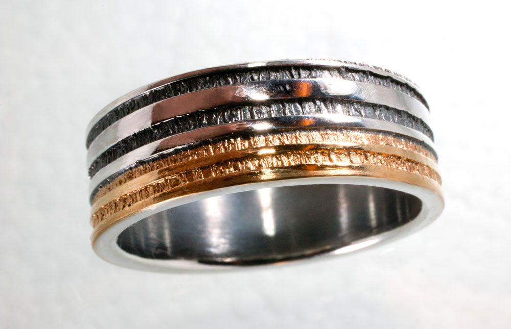 Vigselring i guld och silver