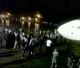 Photos of Angry Arik Air passengers blocking Abuja airport runway
