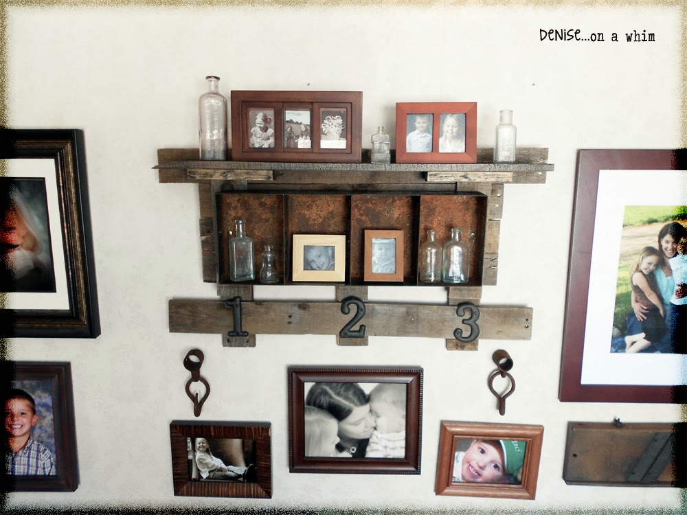 A new rusty shelf on a family gallery wall via http://deniseonawhim.blogspot.com