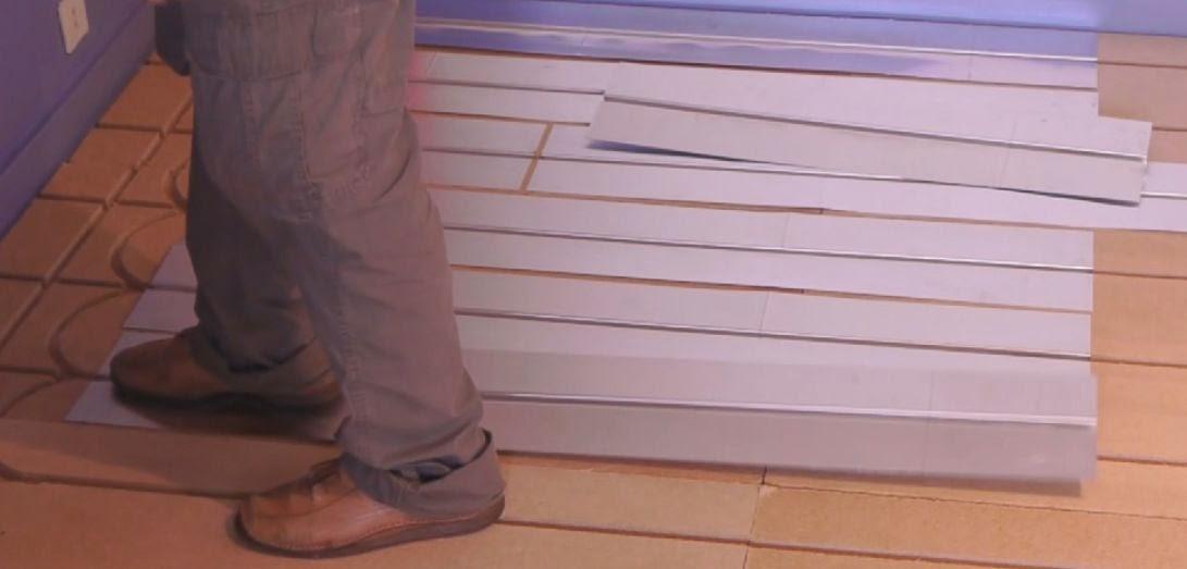 2eme etape de pose du plancher chauffant sec et mince Caleosol Eco+