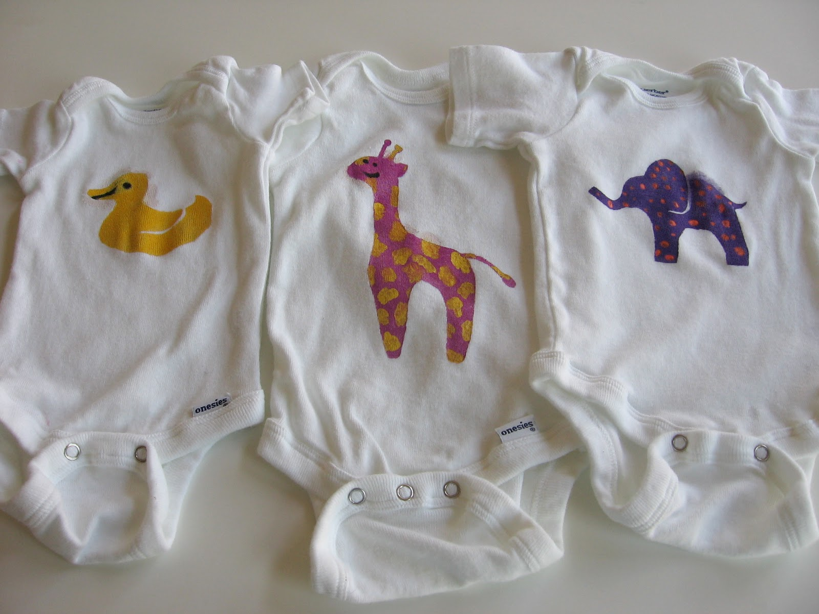 Needle And Spatula Baby Shower Activity Decorating Onesies With