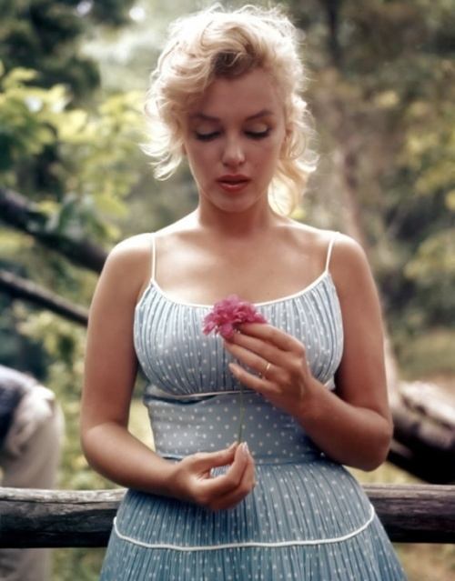 Marilyn Monroe in a romantic polka dot light blue dress